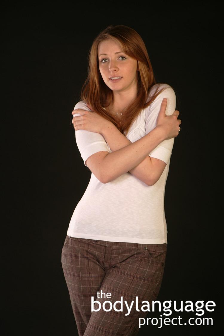 BodyLanguageProjectCom-Double-Arm-Hug-Or-Self-Hugging-3.jpg