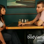 BodyLanguageProjectCom - Incomplete Arm Crossing Or Incomplete Crossed Arms 1