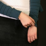 BodyLanguageProjectCom - Masked Arm Crossing Or Masked Crossed Arms 4
