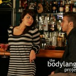BodyLanguageProjectCom - Sideways Glance Over Raised Shoulder 2